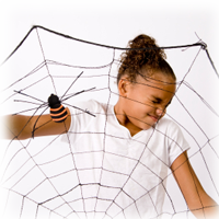girl holding giant spider web decoration