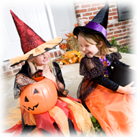 two girls in witch costumes